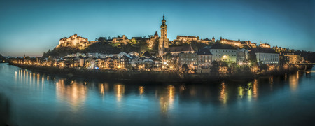 Germany, Burghausen, view to the lighted city with River Salzach in the foreground