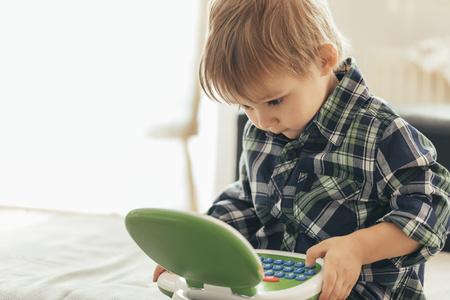 Boy using toy laptop