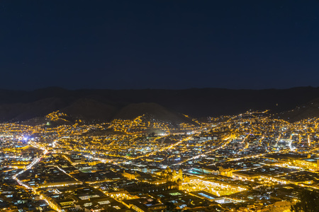 Peru, Andes, Cusco, cityscape as seen from Cristo Blanco Statue at blue hour