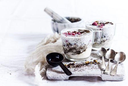 Glasses of yogurt dessert with chia, roasted hazelnuts and coffee LANG_EVOIMAGES