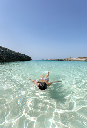 Spain, Menorca, Talaier Beach, girl snorkeling