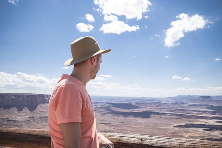 USA, Utah, back view of man with hat looking at Canyonlands