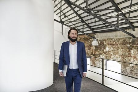 Businessman walking in office loft