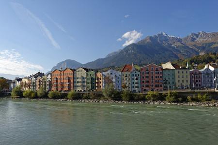 Austria, Tyrol, Innsbruck, colorful houses at Inn river