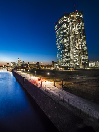 Germany, Frankfurt, lighted European Central Bank and skyline in the background at sunset