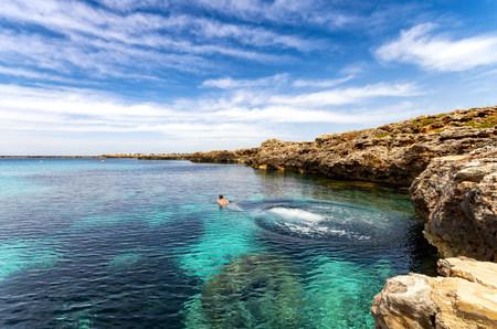 Spain, Menorca, Binissafuller, man diving LANG_EVOIMAGES
