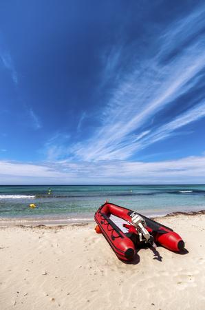 Spain, Menorca, Son Bou, dinghy on the beach