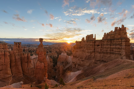 USA, Utah, Bryce Canyon National Park, Thors Hammer and other hoodoos in amphitheater at sunrise as seen from Navajo Loop Trail