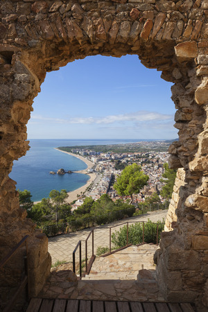 Spain, Catalonia, Blanes town, framed view trough the gate of St. John Castle