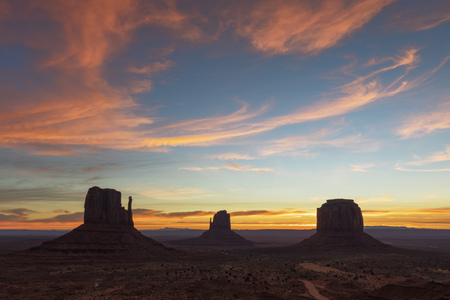 USA, Colorado Plateau, Utah, Arizona, Navajo Nation Reservation, Monument Valley, The View Campground with West Mitten Butte, East Mitten Butte and Merrick Butte at dawn
