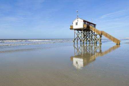 Germany, Schleswig-Holstein, St Peter-Ording, stilt house on the beach
