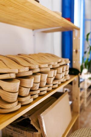 Shoe lasts on shelf in shoemakers workshop