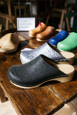 Assortment of clogs on table LANG_EVOIMAGES