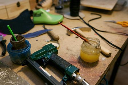 Shoemakers utensils in workshop LANG_EVOIMAGES