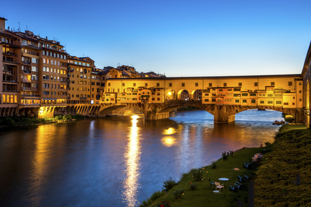 Italy, Tuscany, Florence, view to Arno River and lighted Ponte Vecchio at blue hour