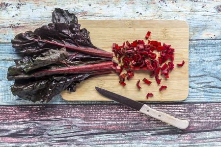Chopped chard on wooden board