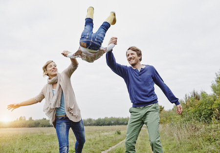 Family on a trip lifting up daughter