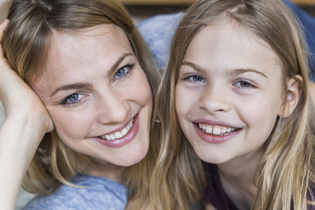 Portrait of happy little girl with her mother