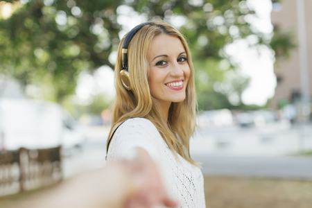 Portrait of smiling blond woman with headphones