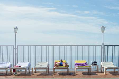 Tourist lying on sun bed of a hotel
