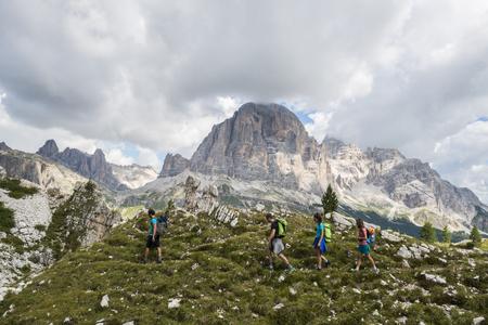 Italy, Friends trekking in the Dolomtes
