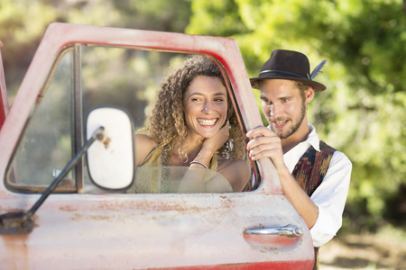 Happy young couple at old pick up truck
