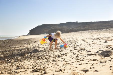 Spain, Fuerteventura, girl playing on the beach