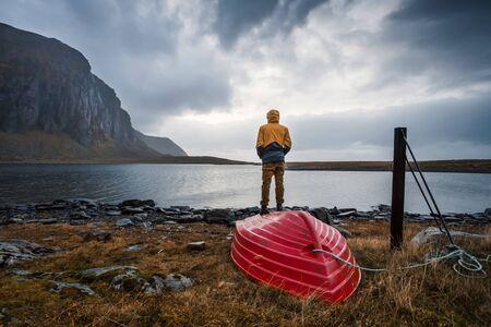 Norway, Lofoten Islands, Eggum, back view of man looking at view LANG_EVOIMAGES