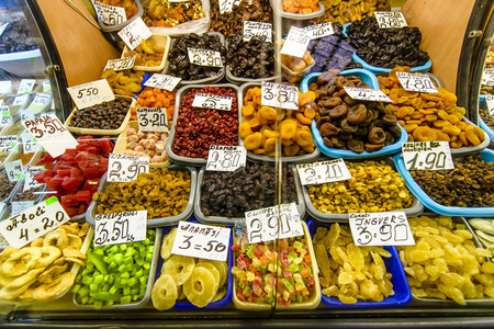 calorific: Dried multi colour fruit on the exotic market with visible prices, many different fruits