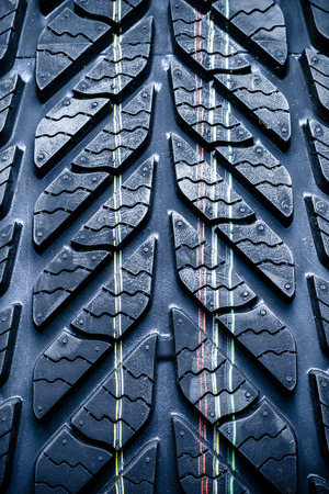 tyre tread: Fragment of new vehicle or car tyre, tire with visible tread and colour mark  Stock Photo
