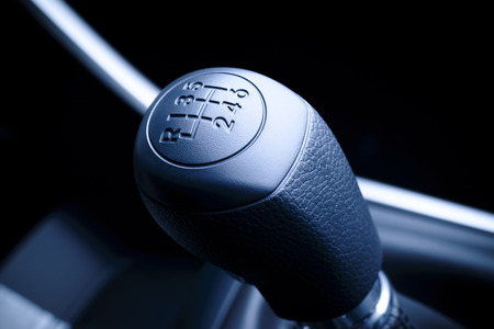 Interior of car, vehicle with visible lever of manual  transmission, with metal, chrome elements