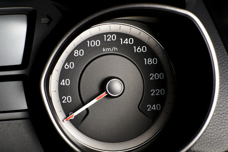 Photo presents car s, vehicle s speedometer or tachometer with visible information display - ignition warning lamp  and brake system warning lamp, visible symbols of instrument cluster   ten check warning light   photo