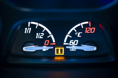 gas gauge: Car, vehicle interior with visible Fuel, gas gauge and Engine coolant temperature gauge with illuminated Information warning lamp visible  Stock Photo