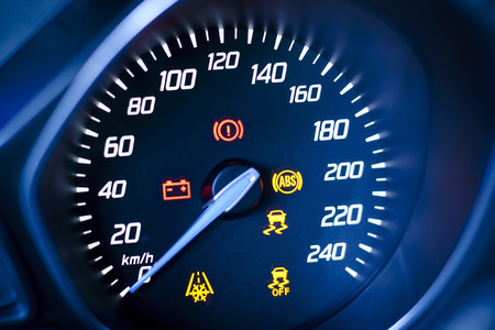 Photo presents car s, vehicle s speedometer or tachometer with visible information display - ignition warning lamp  and brake system warning lamp, visible symbols of instrument cluster   ten check warning light , with warning lamps illuminated  photo