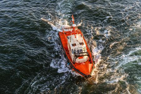 coast guard: Orange and white coast guard lifeboard photographed from bird