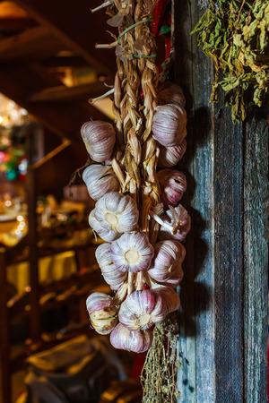 Garlic bulbs hanging on wooden beam  photo