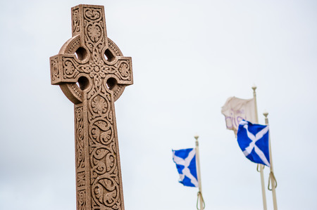 andrew: Old style celtic cross with visible national flags of Scotland - St Andrew