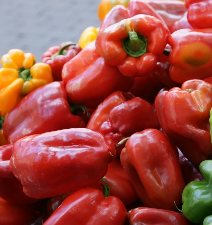 extensively: Red Sweet pepper, Capsicum annuum, annual herb with bell-shaped drooping fruits turning from green to yellow and finally red when mature  Extensively used in salads, stuffed and several other recipes, especially stir-fried