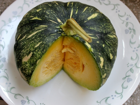 cucurbita: Cucurbita moschata, commonly sold in Indian markets under the name kadu, petha or sita phal  young fruit green with yellowish-white patches  Flesh initially light yellow turning orange yellow when ripe  Commonly cooked as vegetable   Stock Photo