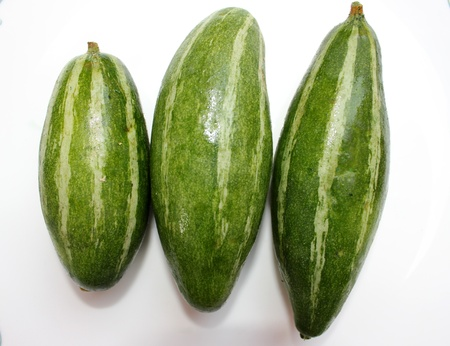 Pointed gourd, parwal, Trichosanthes dioica, an annual vine with unlobed leaves, white beautiful flowers and 5-12 cm long fruits pointed at ends, green with white stripes  Used as vegetable