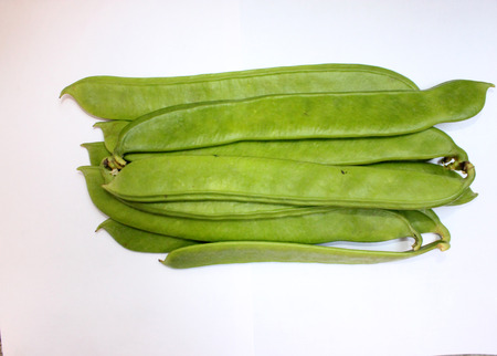 Sword bean, Canavalia gladiata, scimitar bean, Vine with sword-like flat pods up to 30 cm long and up to 5 cm broad with large 25-30 mm long seeds  Pods as vegetable Stock Photo - 22507520