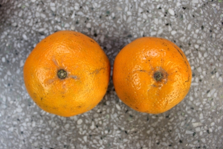Kinnow, Citrus reticulata, a possible hybrid between King Tangor and Willowleaf mandarine, commonly cultivated in India and elsewhere, orange-yellow slightly depressed fruits with closely packed segments  Sweet with distinctive flavor Stock Photo - 24426132