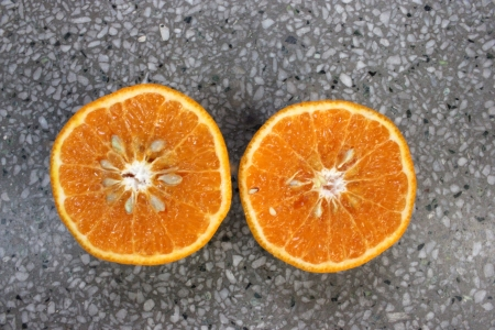 Kinnow, Citrus reticulata, a possible hybrid between King Tangor and Willowleaf mandarine, commonly cultivated in India and elsewhere, orange-yellow slightly depressed fruits with closely packed segments  Sweet with distinctive flavor Stock Photo - 24426137