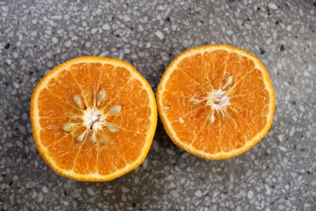 Kinnow, Citrus reticulata, a possible hybrid between King Tangor and Willowleaf mandarine, commonly cultivated in India and elsewhere, orange-yellow slightly depressed fruits with closely packed segments  Sweet with distinctive flavor Stock Photo - 24429013
