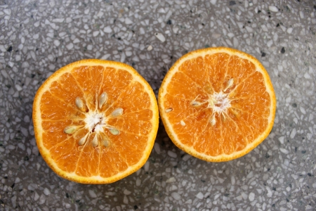 Kinnow, Citrus reticulata, a possible hybrid between King Tangor and Willowleaf mandarine, commonly cultivated in India and elsewhere, orange-yellow slightly depressed fruits with closely packed segments  Sweet with distinctive flavor  Stock Photo - 24429015