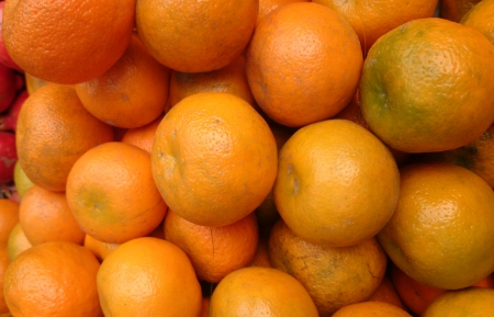 Kinnow, Citrus reticulata, a possible hybrid between King Tangor and Willowleaf mandarine, commonly cultivated in India and elsewhere, orange-yellow slightly depressed fruits with closely packed segments  Sweet with distinctive flavor  Stock Photo - 24594476