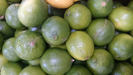 acidic:  Lime fruit, Citrus aurantifolia, Evergreen tree with unifoliate leaves, white flowers and green fruit 5-8 cm with acidic juicy segments, used for juices, lemonades and salads