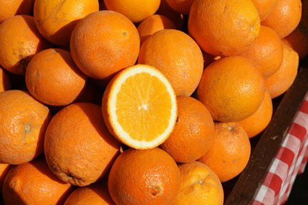 rutaceae: California Navel orange, Citrus sinensis, Rutaceae, a cultivar resulting from mutation having an opening like human navel at tip and through which a second small fruit often emerges, thick skinned, flesh orange yellow preferred as table fruit