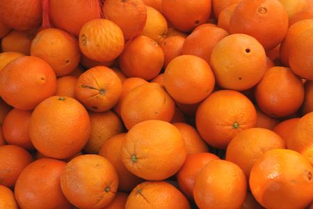 navel orange: Cara Cara orange, Citrus sinensis  Cara Cara , a cultivar of navel orange with red flesh, hybrid between Washington navel and the Brazilian Bahia navel, having typical navel at one end, sweet juice with a taste of many fruits  Stock Photo