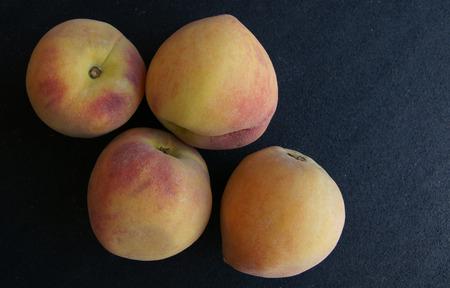 greenish: Yellow peach, Prunus persica, cultivar with yellow skin with greenish yellow blush, flesh yellow, soft, sweet and juicy, a temperate fruit